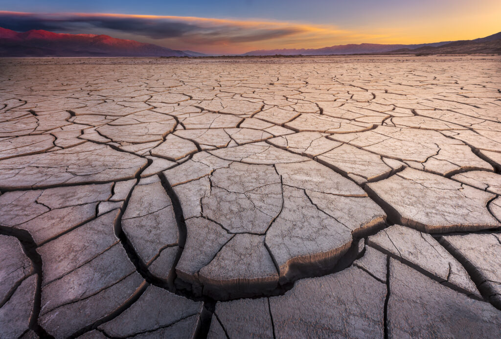 Desolate mud flat basin in Death Valley, CA - Adobe Stock photo