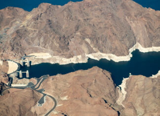 "After two decades of drought, Lake Mead, which is impounded by Hoover Dam, is just 40 percent full. A ""bathtub ring"" visible along the edges of the lake show how far its water levels have dropped. PHOTO BY TED WOOD. SUPPORT FOR AERIAL PHOTOGRAPHS PROVIDED BY LIGHTHAWK"