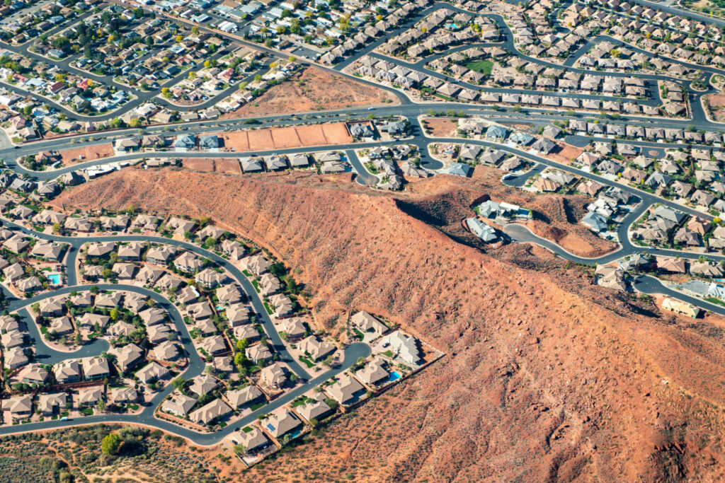 St. George, Utah has been growing rapidly, with subdivisions and golf courses pushing into the desert. Its population has grown from 20,000 to 150,000 in the last 20 years. Photo by Ted Wood