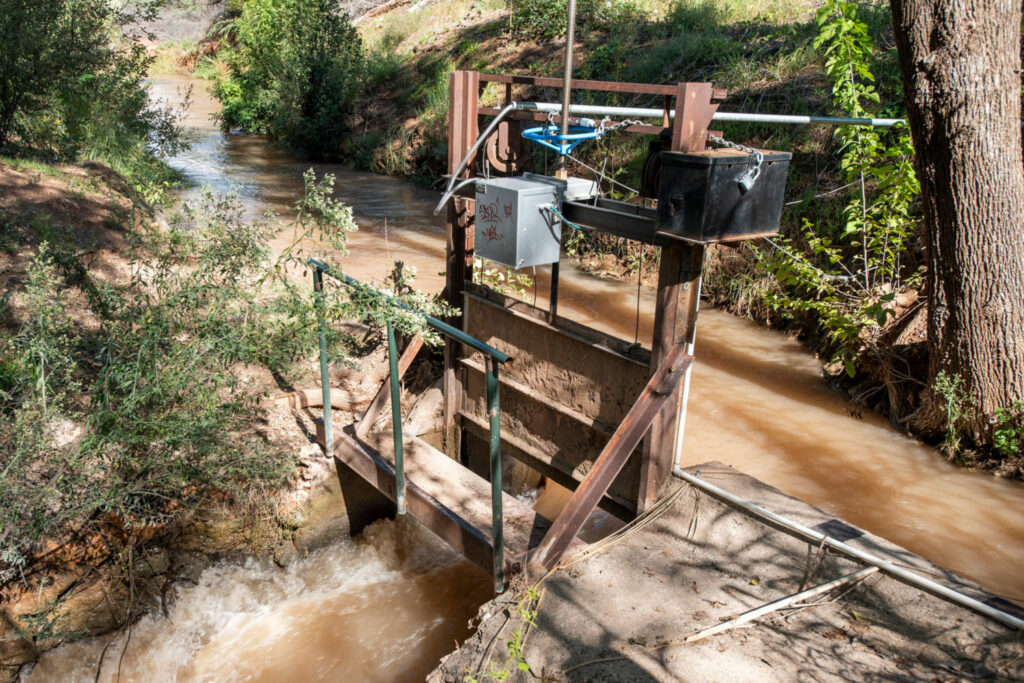 Newly installed headgates divert Verde River water onto fields and allow farmers to control the flow remotely using their smartphones. The computerized equipment was funded by private companies in Phoenix.