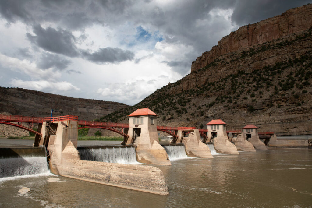 The Grand Valley Diversion Dam, completed in 1916, channels water from the Colorado River to western Colorado's peach orchards and vast agricultural fields.