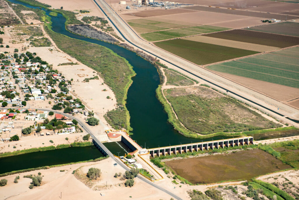 The Morelos Dam on the U.S.-Mexico border, where the Colorado's remaining water, 1.5 million acre-feet, is diverted to cities and farms in Mexico. Below the dam, the original Colorado River channel is dry. PHOTO BY TED WOOD. SUPPORT FOR AERIAL PHOTOGRAPHS PROVIDED BY LIGHTHAWK