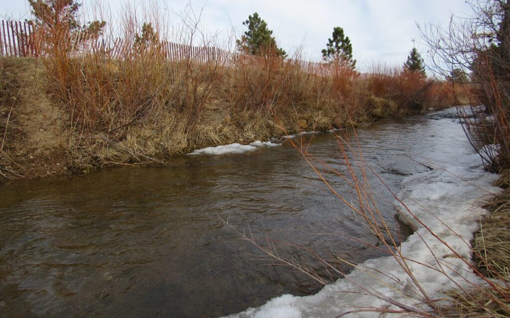 An irrigation ditch flows on the Marshall Mesa in Boulder County. A new USDA report shows little progress has been made in reducing overall ag water use in the state, despite millions of dollars spent on water-saving projects. Credit: Jerd Smith