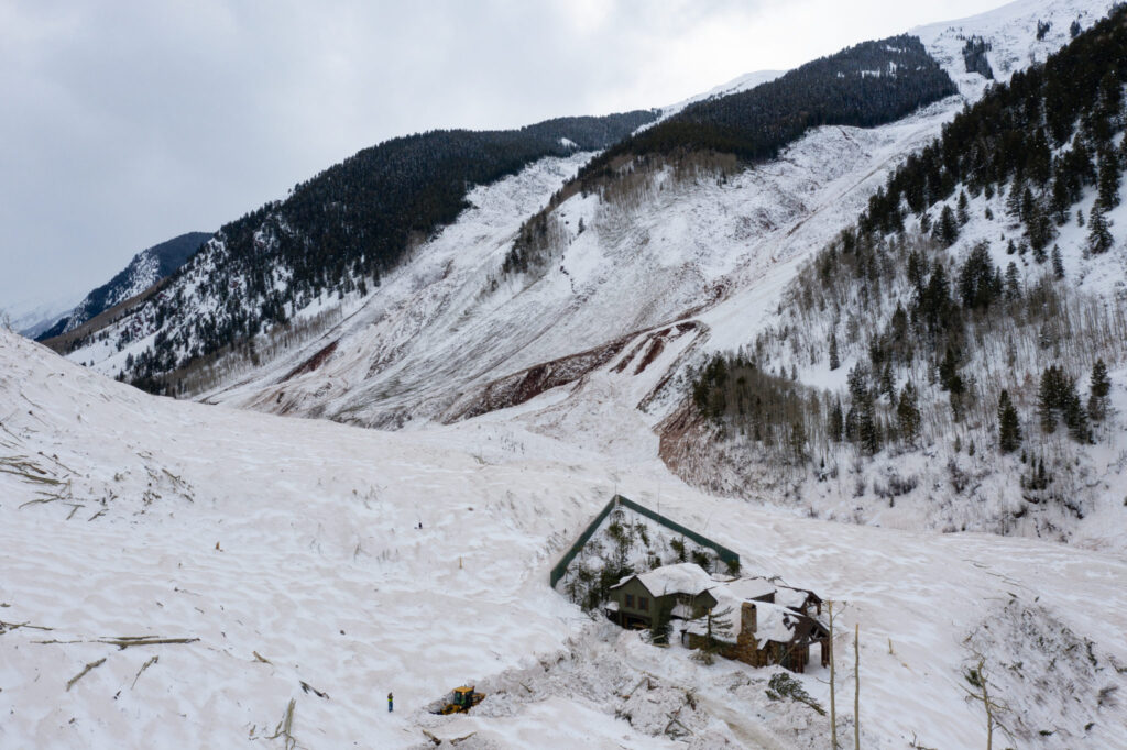 The avalanche that fractured across a nearly two-mile-wide section of Highlands Ridge in March 2019 was one of the largest in Colorado history. A home in its path survived with minimal damage thanks to a defensive wedge above it. Courtesy of Brandon Huttenlocher/CAIC
