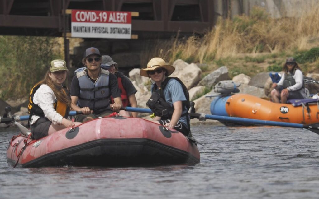 Along with lower river flows the presence of COVID-19 is creating challenges for commercial river running companies as well as private boaters.   Rafters enjoy a day on the Gunnison River near Gunnison, Colo., on May 17, 2020. The Gunnison is flowing at about 80 percent of its normal volume for this time of year. Overall, Colorado's snowpack is melting faster than usual. Along with lower river flows the presence of COVID-19 is creating challenges for commercial river running companies as well as private boaters. Credit: Dean Krakel/Special to Fresh Water News