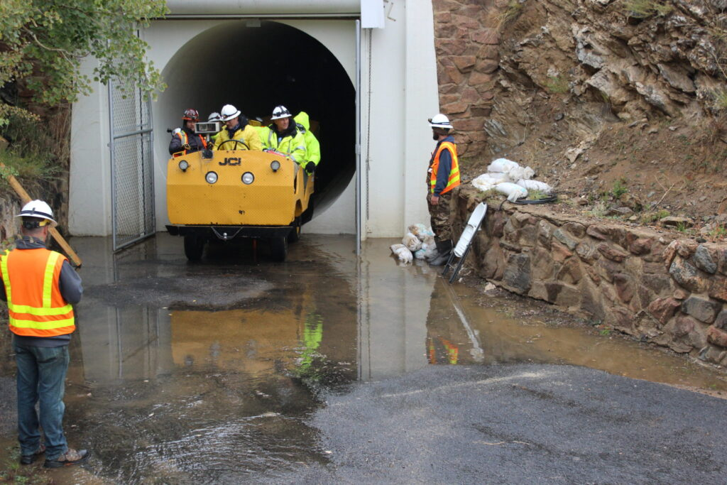 An inspection team leaving the 23-mile Roberts Tunnel east portal in Park County in 2016. The tunnel, which diverts water from the Blue River to the Front Range is inspected every five years. Photo credit: Denver Water