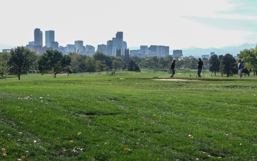 Golfers take shots on the green lawns of the City Park Golf Course in central Denver on Sept. 28 2020