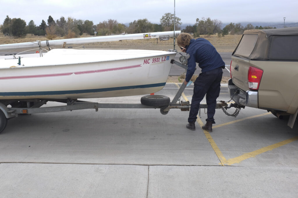 Park ranger Geraint Mansfield examines the registration of a boat headed into Chatfield Reservoir, near Denver, on Oct. 18. Since 2008, the state has had an inspection program designed to keep invasive zebra and quagga mussels — which can damage infrastructure and disrupt the aquatic food chain — out of Colorado waterways.