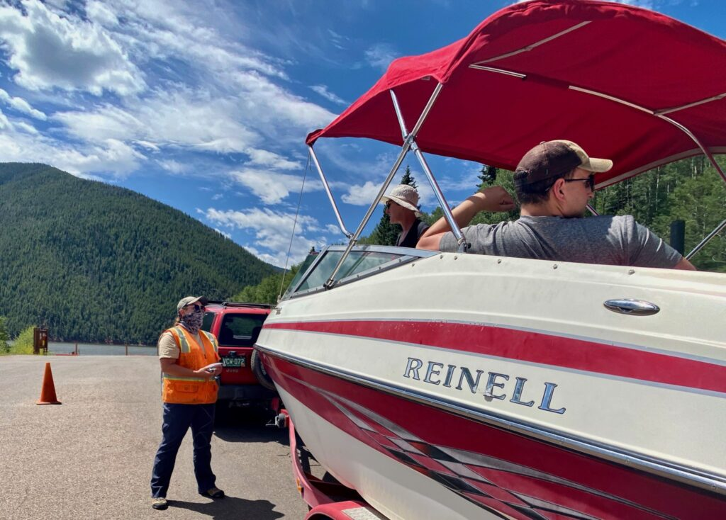 An inspector from Rocky Mountain Recreation begins the boat-inspection process at Ruedi Reservoir in July. Seventeen boats at Ruedi were found to have invasive zebra and quagga mussels this season.