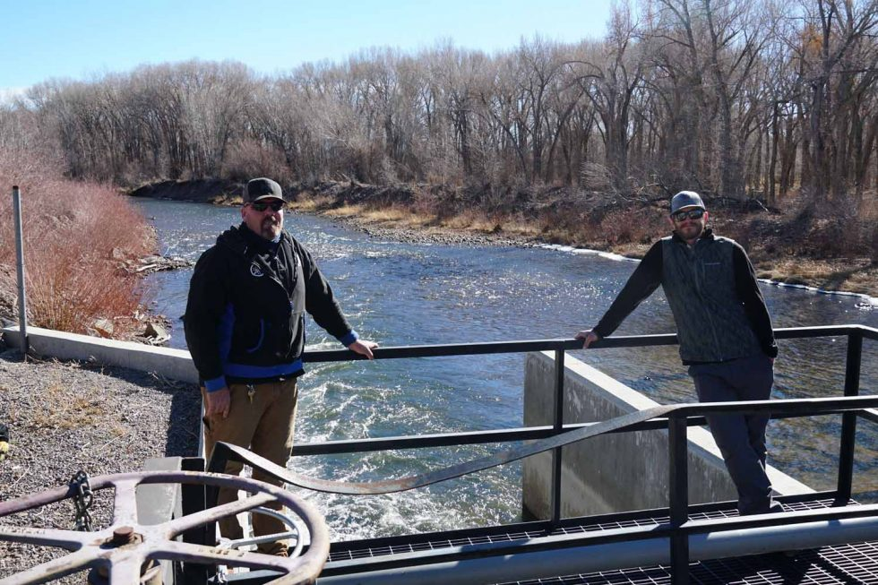 Nathan Coombs, left, and Kevin Terry at the Manassa gate on the Conejos River. Credit: Susan Moran